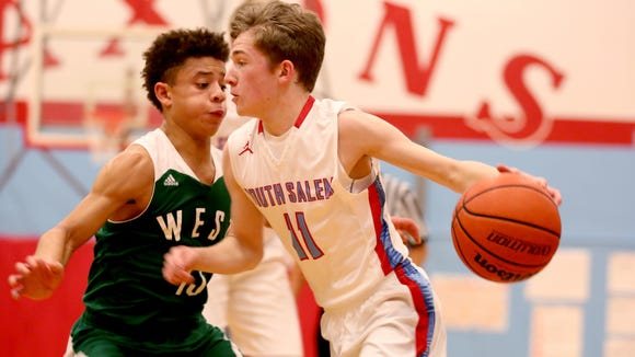 South Salem's Tyler Wadleigh (11) moves with the ball past West Salem's Isaiah Pineda (13) in the first half of the West Salem vs. South Salem boy's basketball game at South Salem High School on Tuesday, Dec. 15, 2015.