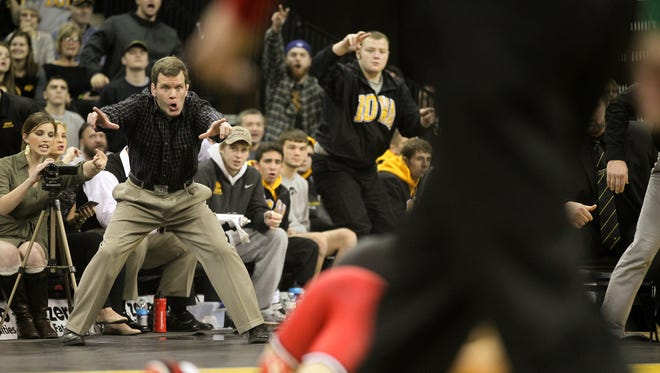 Iowa associate head coach Terry Brands calls for takedown points as Topher Carton wrestles Rutgers' Anthony Ashnault at 141 pounds at Carver-Hawkeye Arena on Thursday, Dec. 10, 2015. Carton lost by decision, 8-4.