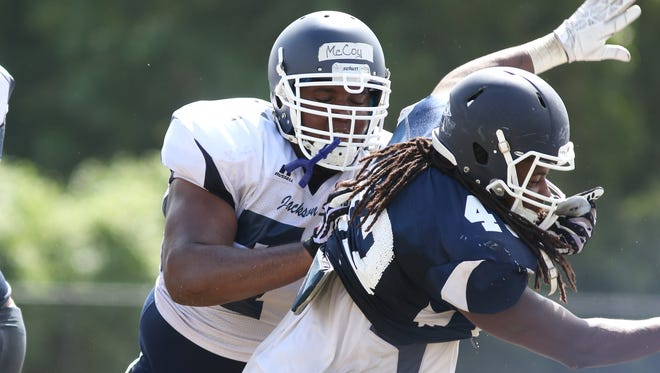 Jackson State offensive lineman Brandon McCoy (white) has primarily worked with the first-team offense at right tackle.