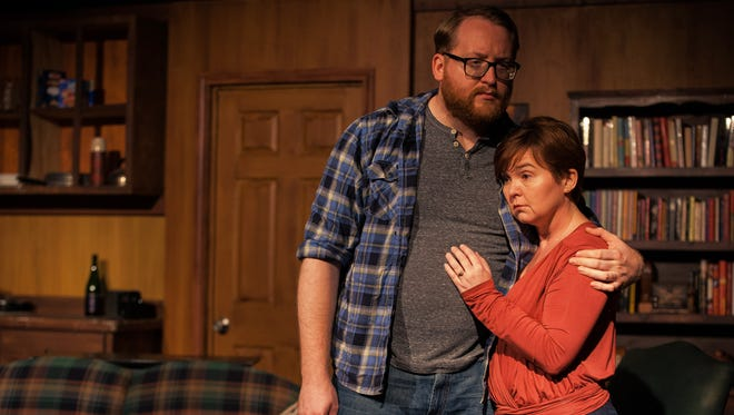 """Bobby (Travis Nichols) and Betty (Theresa Davis) play disparate siblings in the contemporary drama """"In A Forest, Dark and Deep,"""" playing at Theatre Tallahassee until Oct. 9."""