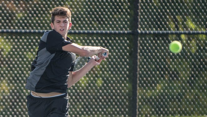 Marshall senior Cole Varvatos during the Interstate Eight Tennis Championships held at Harper Creek on Monday.
