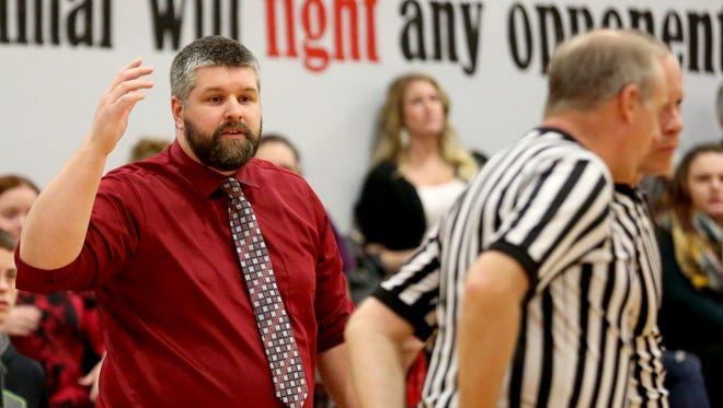 Santiam head coach JD Hill talks to a referee in the Kennedy vs. Santiam boy's basketball game at Santiam High School in Mill City on Tuesday, Dec. 20, 2016. Kennedy won the game 58-51 in overtime.