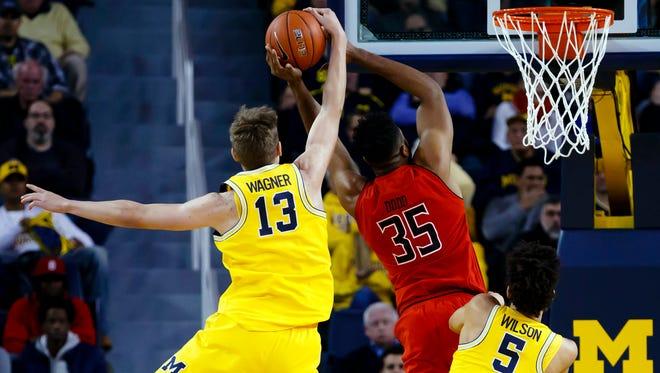 Jan 7, 2017; Ann Arbor, MI, USA; Michigan Wolverines forward Moritz Wagner blocks a shot by Maryland Terrapins forward Damonte Dodd in the first half at Crisler Center.
