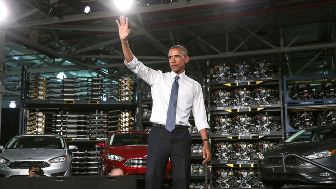 In this January, 2015 photo, President Barack Obama waves to the crowd at the Ford Motor Company Michigan Assembly Plant in Wayne after giving a speech highlighting the workers in the resurgent American automotive and manufacturing sector after the auto rescue.