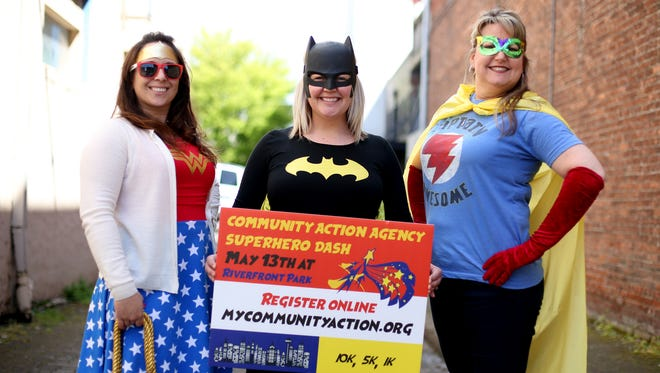 Mitzi Smith, from left, Liz Henderson and Cyndi Leinassar dress in their best for the Community Action Agency's Superhero Dash at Riverfront Park on May 13.