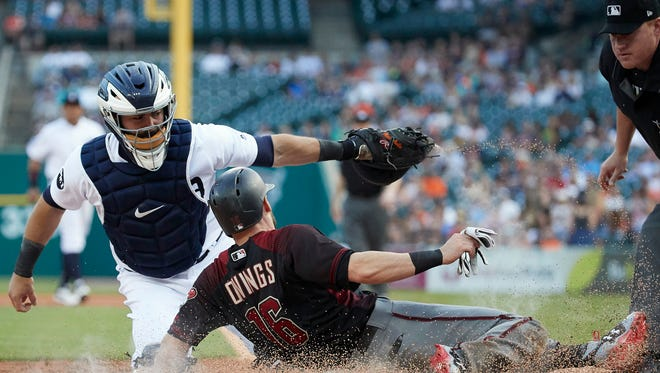 Jun 14, 2017; Detroit, MI, USA; Diamondbacks shortstop Chris Owings is tagged out at home by Tigers catcher Alex Avila in the first inning at Comerica Park.