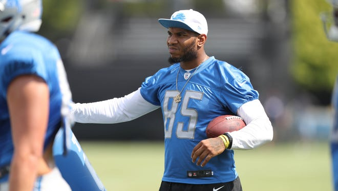 Lions tight end Eric Ebron watches training camp drills Tuesday, August 1, 2017 in Allen Park.