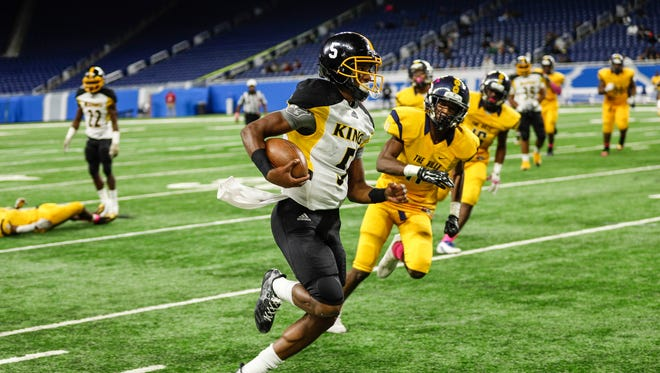Detroit King quarterback Dequan Finn keeps the ball for a run against East English Village during the Detroit Public School League championship game at Ford Field, Friday, Oct. 20, 2017.