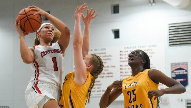 St. Lucie West Centennial's Raquel Tolbert (1) shoots as Fort Pierce Central's Maryanne Logsdon (center) defends Tuesday, Feb. 20, 2018, during their high school basketball game at St. Lucie West Centennial High School in Port St. Lucie. To see more photos, go to TCPalm.com.
