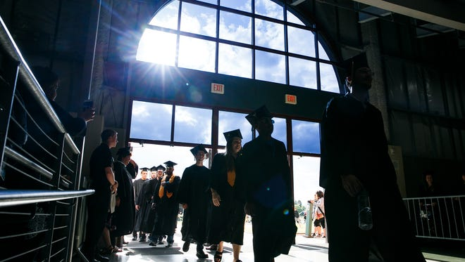Graduates enter the pavilion at the Oregon State Fairgrounds for the 62nd annual Chemeketa Community College graduation on Friday, June 15, 2018.