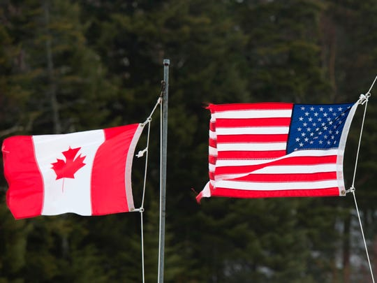 This photo taken on March 1, 2017, shows the Canadian and American flags seen at the U.S./Canada border in Pittsburg, N.H.