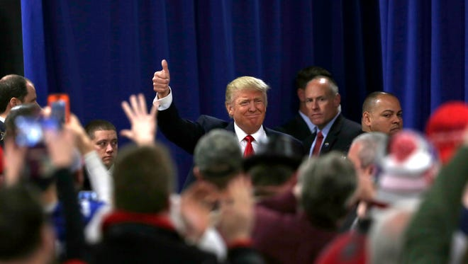 Donald Trump gives a thumbs up as he enters a town hall event in Rothschild, Wisconsin, April 2, 2016.