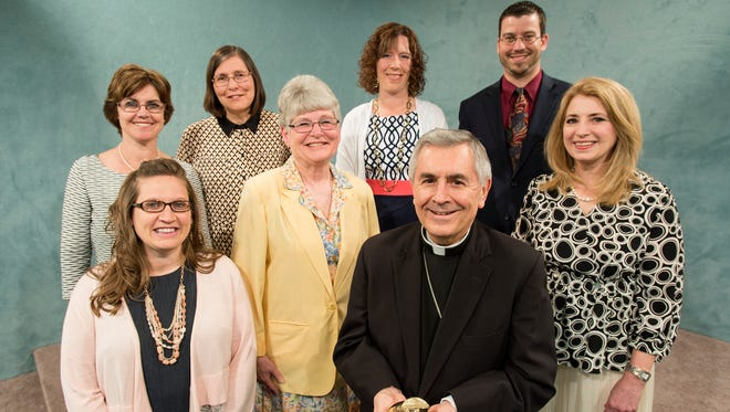 Recipients receive the Golden Apple Award from the Harrisburg Diocese. Back from left: Linda Hostetter, Ann DiNovis, Stephanie Kveragas, Gary Jon Hatez. Front from left: Megan Wertz, Maureen Theic, Bishop Ronald Gainer and Amy Erb.