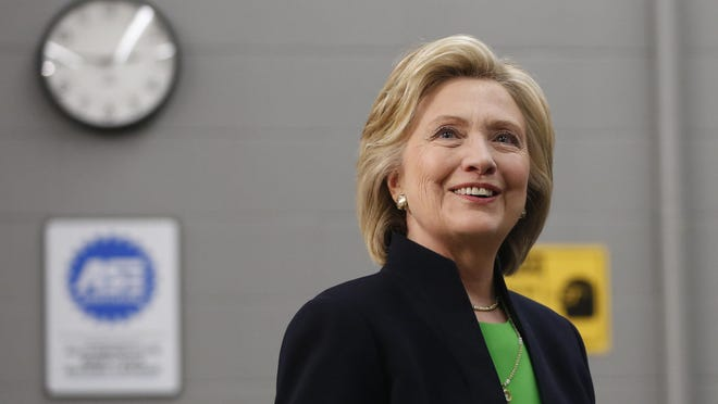 Hillary Clinton Democrat Hillary Clinton smiles at members of the media April 14 following a roundtable at Kirkwood Community College's satellite campus in Monticello, Ia.