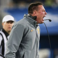 Tennessee head coach Butch Jones yells to his team during the second half of a game against Kentucky on Saturday, Oct. 31, 2015, in Lexington, Ky. Tennessee won 52-21.