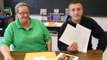 Somerset Hills Teacher Jan Foley and student Thomas Kasper show a letter Thomas received from First Lady Michelle Obama as part of a school project.