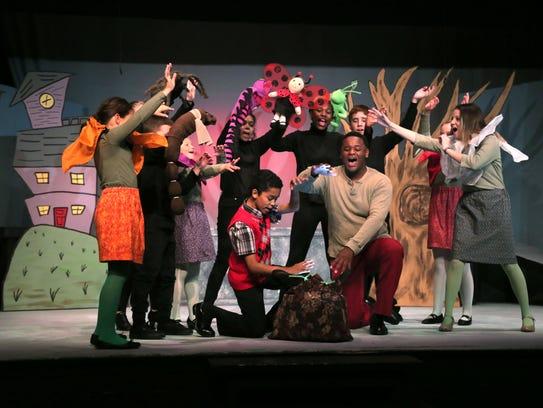 Members of the Mansfield Community Playhouse cast rehearse