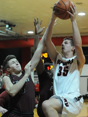 Gopher senior Kale Morris drives to the basket hard against Faith Christian's Luke Peter Friday night as Clinton Prarie hosted the Eagles.