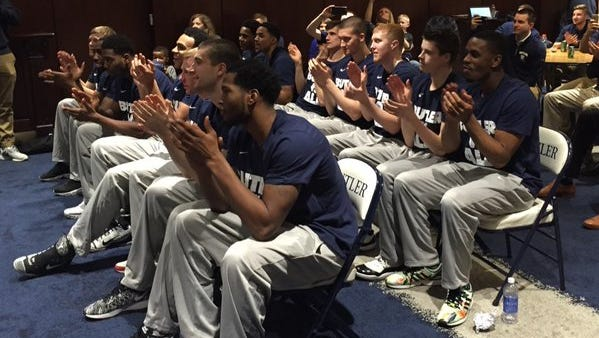 Butler men's basketball players watch as their team is called during Selection Sunday.