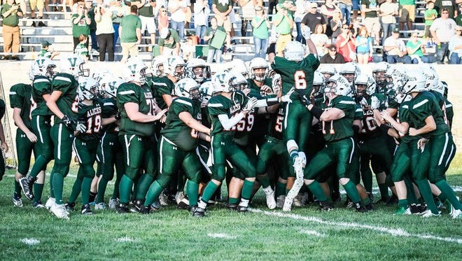 The Vincennes Lincoln football team psyches itself up before a game last season.