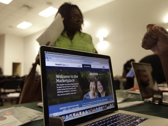 Insurance customers enroll in health plans. Heathcare.gov