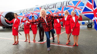 Sir Richard Branson, president of Virgin Atlantic, helps launch the carrier's new service between London Heathrow and Seattle-Tacoma International Airport.