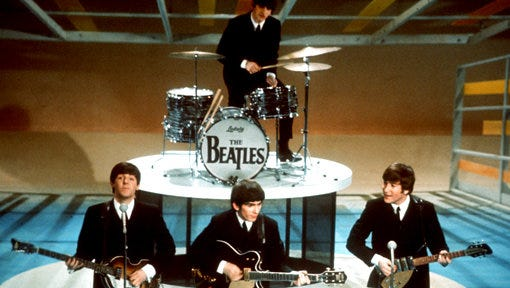 """FILE - In this Feb. 9, 1964, file photo, the Beatles perform on the CBS """"Ed Sullivan Show"""" in New York. Sirius announced Tuesday, May 2, 2017, that it is achieving a long-sought dream with its own Beatles channel, starting on May 18, 2017."""