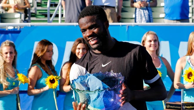 Frances Tiafoe of the U.S. holds the trophy after he defeated Peter Gojowczyk of Germany 6-1, 6-4 in his first ATP World Tour win in the Delray Beach Open.