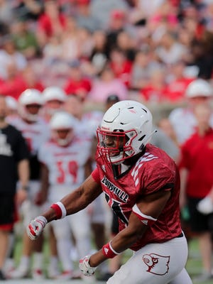 Louisville's Dee Smith celebrates after making a tackle. April 13, 2018