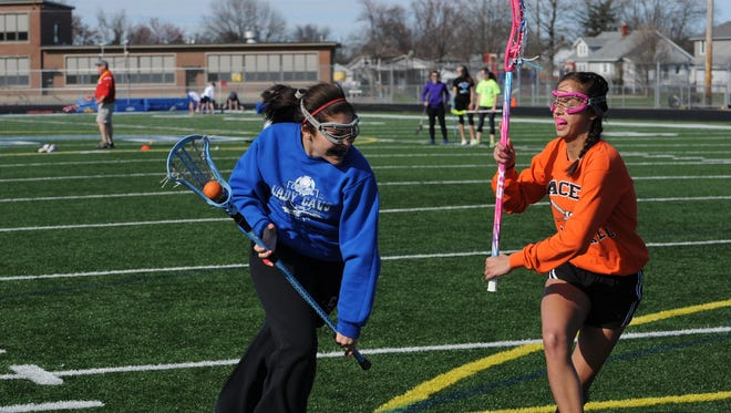 Chillicothe's Tia Hoosier, left, drives past a teammate to the goal during practice Friday at Herrnstein Field.