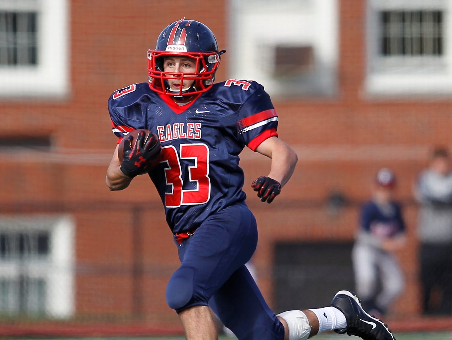 Eastchester running back John Guido (33) finds a hole for a short gain during their 19-27 loss to Our Lady of Lourdes High School in the class A semi-final football game in Eastchester on Saturday, Oct. 31, 2015.