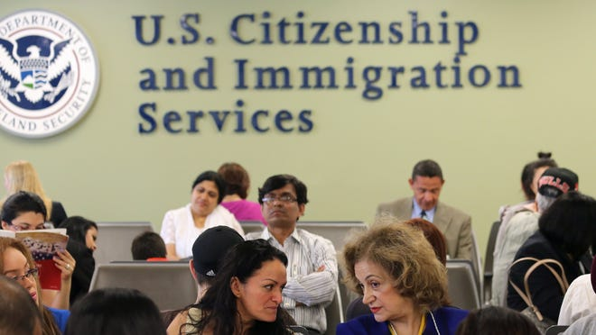 People await their turn for interviews at the U.S. Citizenship and Immigration Services office in New York City.