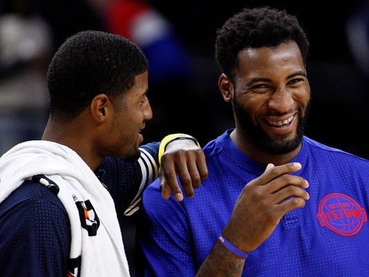 Paul George and Andre Drummond