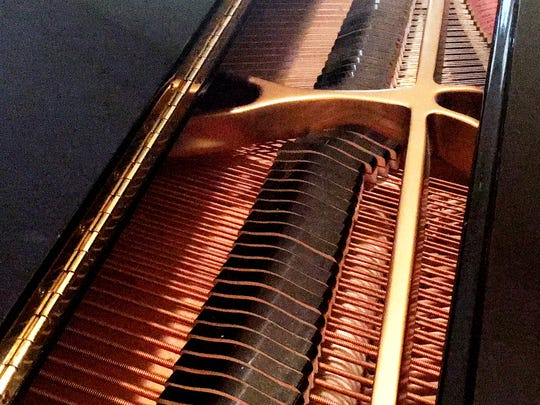 A piano at The Glen Retirement System played by resident