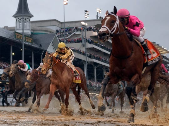 Luis Saez rides Maximum Security, right, across the finish line first against Flavien Prat on Country House during the 145th running of the Kentucky Derby horse race at Churchill Downs Saturday, May 4, 2019, in Louisville, Ky. Country House was declared the winner after Maximum Security was disqualified following a review by race stewards. (AP Photo/Matt Slocum)