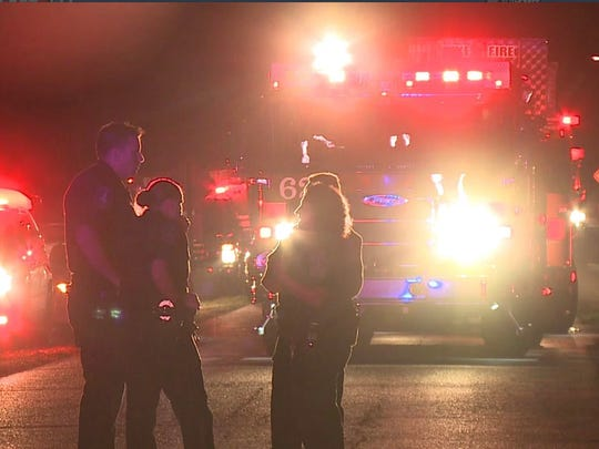 Indianapolis police officers are seen at the scene of the arson fire in the 7200 block of Highland Road. Homicide detectives later arrested a 16-year-old in Adams County and preliminarily charged him with murder and arson in the case.