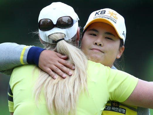 Inbee Park hugs Brittany Lincicome after the round on Saturday at the 2014 Wegmans LPGA Championship at Monroe Golf Club.