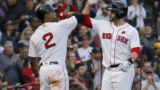 Xander Bogaerts (2) and J.D. Martinez could be opponents the first time they take the field at Fenway Park in 2020.