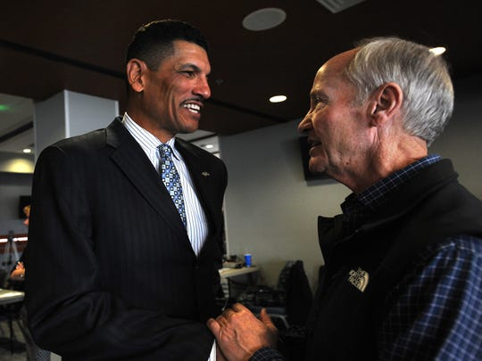 First-year Wolf Pack head football coach Jay Norvell, left, and Chris Ault have already built a strong relationship.