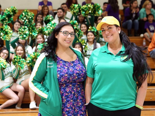 Coachella Valley High School head cheer coach Raquel Hernandez, left, and assistant cheer coach Raquel Canela are both cancer survivors.