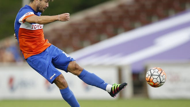 FC Cincinnati forward Andrew Wiedeman (23) takes a shot on goal in the first half during the USL soccer game between the Rochester Rhinos and FC Cincinnati, Wednesday, Aug. 24, 2016, at Nippert Stadium in Cincinnati.