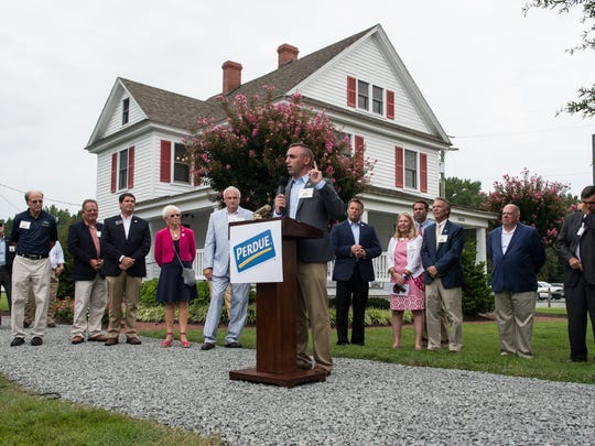 Salisbury Mayor Jake Day speaks to an audience during a ceremony commemorating the 100-year anniversary of the Perdue Family Farmhouse on Monday, Aug. 21, 2017.