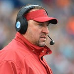 Arkansas head coach Bret Bielema watches the action during a game against Ole Miss at Vaught-Hemingway Stadium.