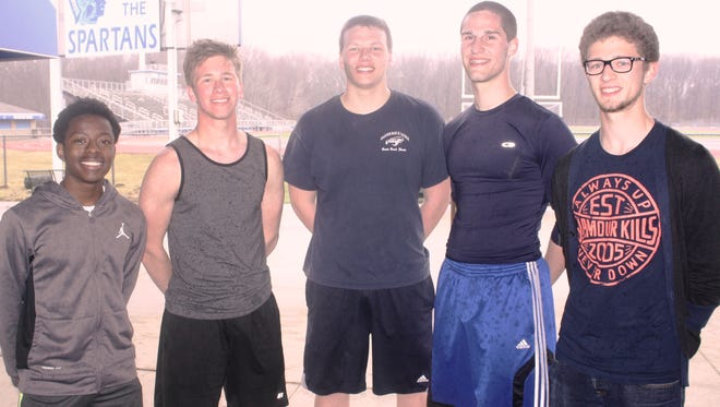 Pictured from left are Livonia Stevenson track-and-field athletes Ladarius Sharpe, Christian Sullivan, Nick Hitchcock, Mike Muffler and Erik Grisa.