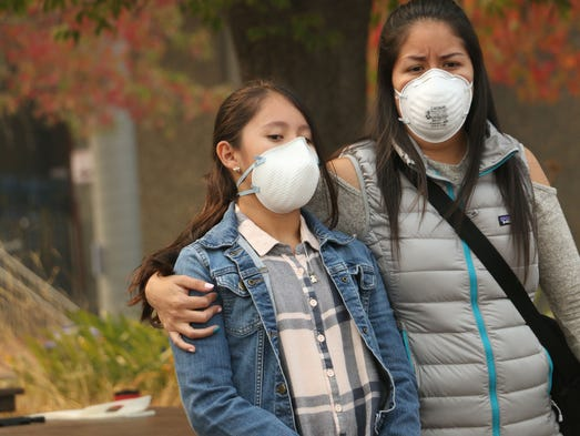 Fire evacuees gather at Napa Valley College in Napa,