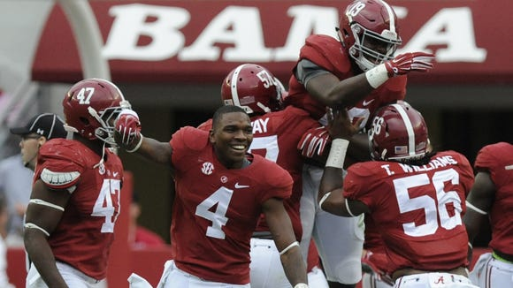 Reggie Ragland (19) celebrates with teammates Saturday after intercepting a pass. Alabama fans also are giddy with excitement again after the Crimson Tide?s dominating performance in Saturday?s 59-0 victory over Texas A&M. Alabama linebacker Reggie Ragland (19) celebrates with teammates after intercepting a pass against Texas A&M at Bryant-Denny Stadium in Tuscaloosa, Ala. on Saturday October 18, 2014.