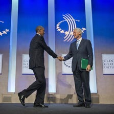 President Obama is greeted by former president Bill Clinton at the Clinton Global Initiative in New York, on Sept. 23, 2014.