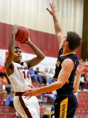 Riverdale's Deron Perry (14) goes up for a shot as