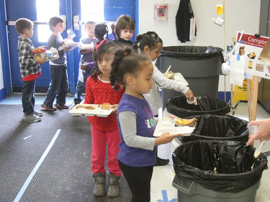 Young students sort their recyclables after lunch at Ridgeway Elementary School in White Plains.