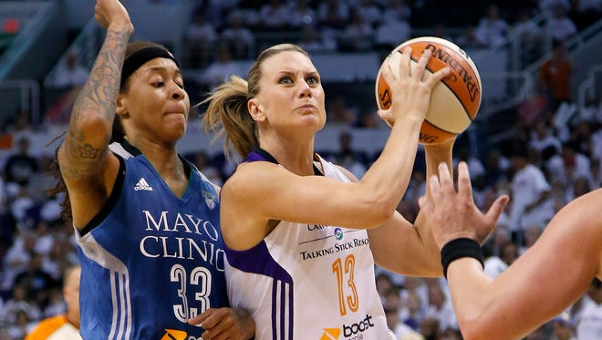 Phoenix Mercury's Penny Taylor, of Australia, drives past Minnesota Lynx's Seimone Augustus during the second half in Game 1 of the WNBA basketball Western Conference finals Friday, Aug. 29, 2014, in Phoenix. The Mercury defeated the Lynx 85-71.